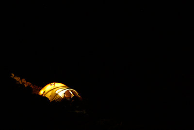 Yellow tent is surrounded by pure blackness - p3433636 by Patrik Lindqvist