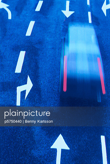 A car in movement on a road. - p5750440 by Benny Karlsson