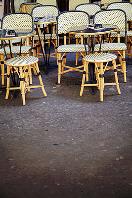 Cafe Tables on Sidewalk - p1248m1589936 by miguel sobreira