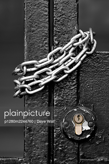 Steel chain on metal gate - p1280m2244760 by Dave Wall