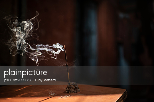 Incense stick burning - p1007m2099037 by Tilby Vattard