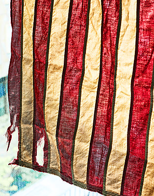 Tattered flag with red and yellow stripes - p1397m2184310 by David Prince