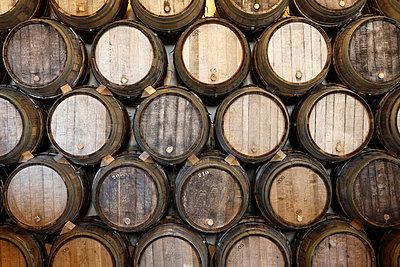 Stacked oak barrels in a winery - p30118797f by Marc Volk