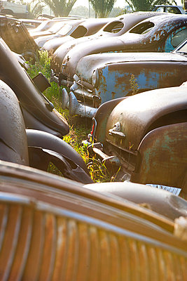 Vintage cars abandoned in scrap yard - p429m875756f by Zero Creatives