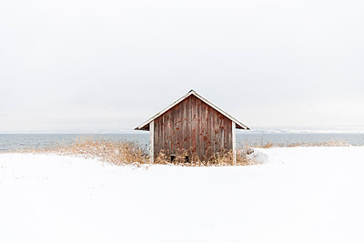 Wooden barn in snow - p352m2120111 by Åke Nyqvist