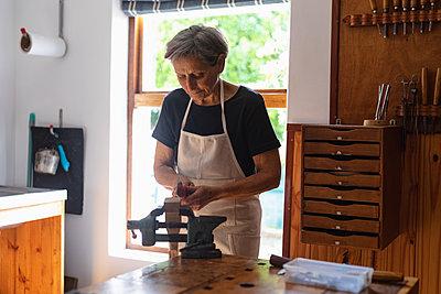 Female luthier at work in a workshop - p1315m2131461 by Wavebreak