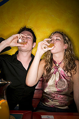 Young couple drinking alcohol - p92410814f by Image Source