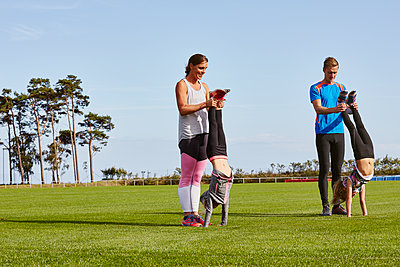 Family exercising together - p312m1558218 by Johner