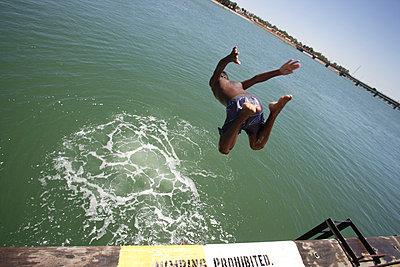 Jumping into water - p1016m792539 by Jochen Knobloch
