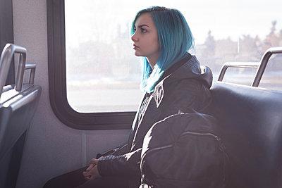 Thoughtful stylish woman travelling in train - p1315m1566152 by Wavebreak