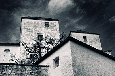 Old houses under cloudy sky - p1445m2148338 by Eugenia Kyriakopoulou