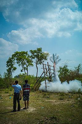 Launching of a rocket during Boun Bang Fai, aka Rocket Festival, Ban Don Nieng, a small village near Vientiane, Laos, Southeast Asia - p934m1451324 by Sebastien Loffler