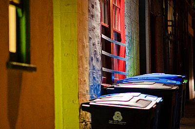 Recycling Bins In Alleyway at Night - p1100m2090798 by Mint Images