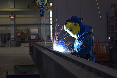Welder at work in factory - p300m1581413 by lyzs