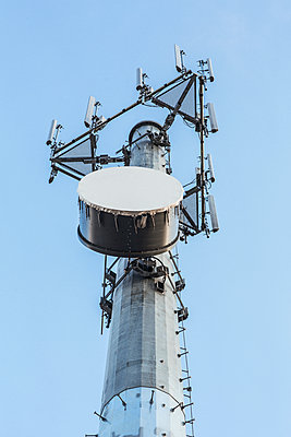 Low angle view of cell tower - p555m1452621 by Eric Raptosh Photography