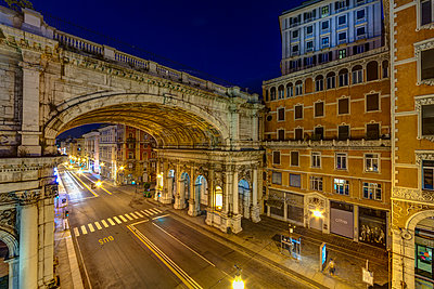 Italy, Genoa, Shopping street Via XX Settembre with Ponte Monumentale at night - p300m981271f by Martin Moxter