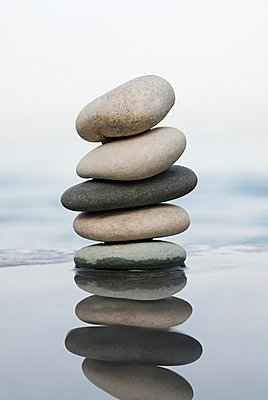 Stack of pebbles - p9248455f by Image Source