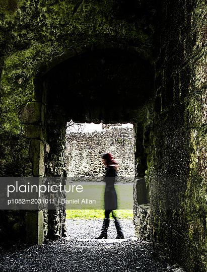 Walking past Stone entrance - p1082m2031011 by Daniel Allan