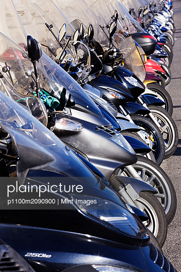 Motor Scooters Parked in Street - p1100m2090900 by Mint Images