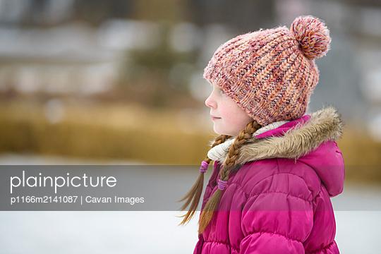 Little Girl Outdoors in Winter - p1166m2141087 by Cavan Images