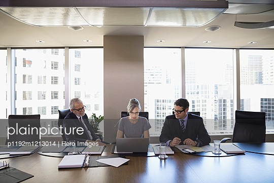 Lawyers using laptop in conference room meeting