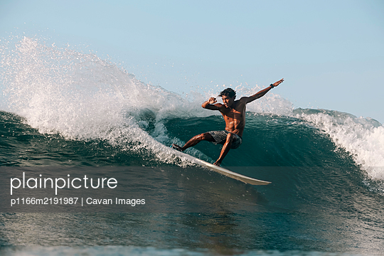 Surfer on a wave, Lombok, Indonesia - p1166m2191987 by Cavan Images