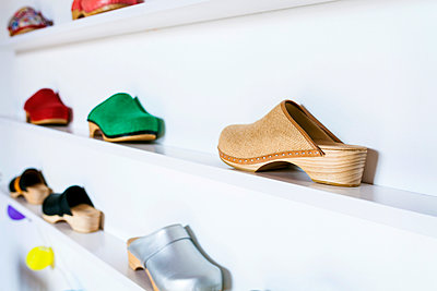Assortment of clogs on shelf - p300m1416502 by Valentina Barreto