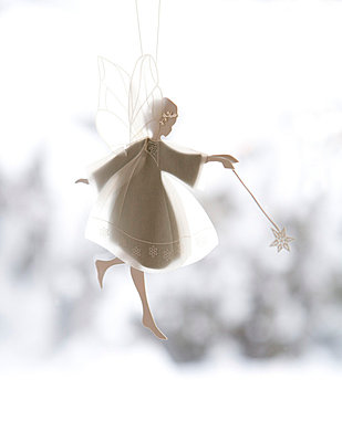 White angel hanging in the window, Christmas decorations   - p8477664 by Erja Lempinen