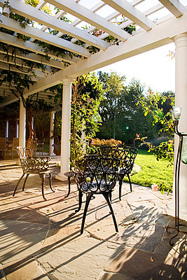 Outdoor Patio With Wrought Iron Dining Set - p5550713f by LOOK Photography