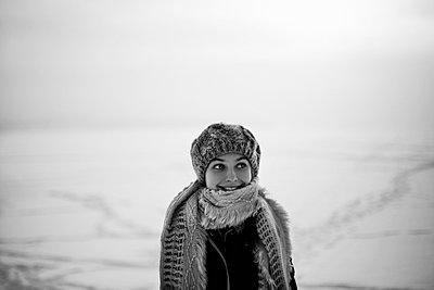 Caucasian teenage girl wearing scarf in snow - p555m1305736 by Vladimir Serov