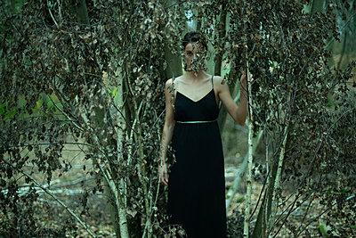 Woman behind tree - p1321m2008276 by Gordon Spooner