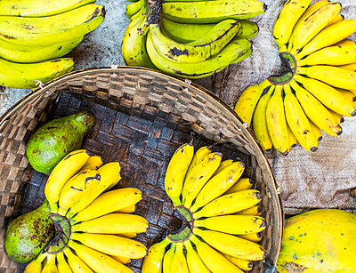 A basket full of bananas at a market in Kerinci Valley, Sumatra, Indonesia.  - p343m1122480f by Modoc Stories
