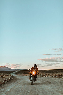 Motorcyclist riding in desert, Trona Pinnacles, California, US - p924m2068164 by Peter Amend