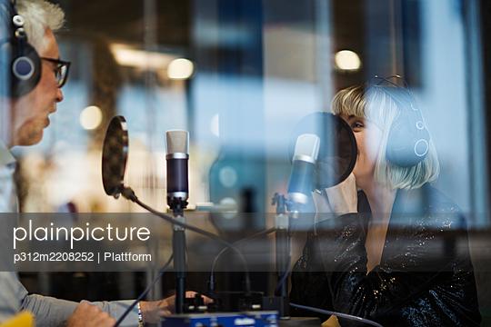 People broadcasting from radio station - p312m2208252 by Plattform