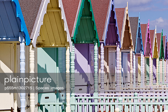 Row of Colorful Beach Homes - p555m1302715 by Spaces Images