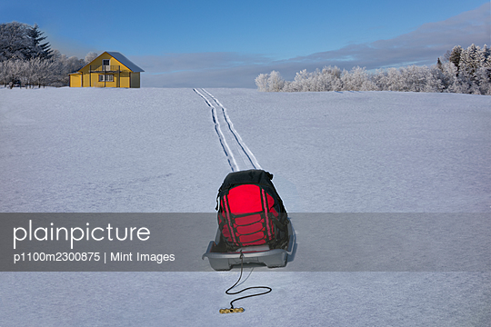 Sled transporting baggage on hilly snowy winter landscape, Estonia - p1100m2300875 by Mint Images