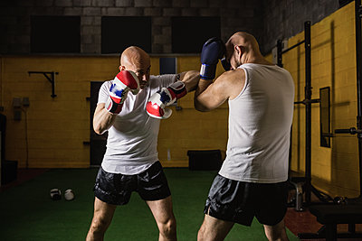 Two boxer practicing boxing in fitness studio - p1315m1198932 by Wavebreak