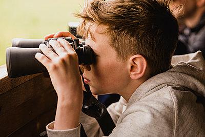 Boy birdwatching with binoculars - p300m1449472 by Nicole Matthews