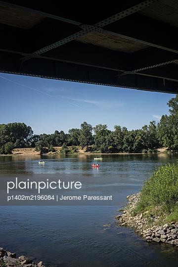 Canoeing on Loire river, view below Gennes Bridge - p1402m2196084 by Jerome Paressant