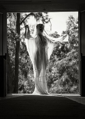 Woman in white dress - p1503m2031850 by Deb Schwedhelm