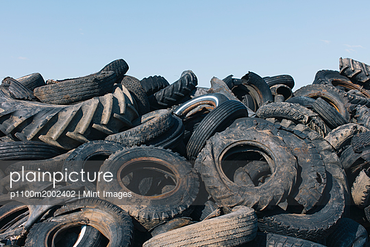 Pile of discarded auto and tractor tires in rural landfil, near Kildeer, Saskatchewan, Canada. - p1100m2002402 by Mint Images