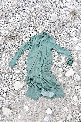 Piece of clothing placed on rocky shore - p1190m2289009 by Sarah Eick