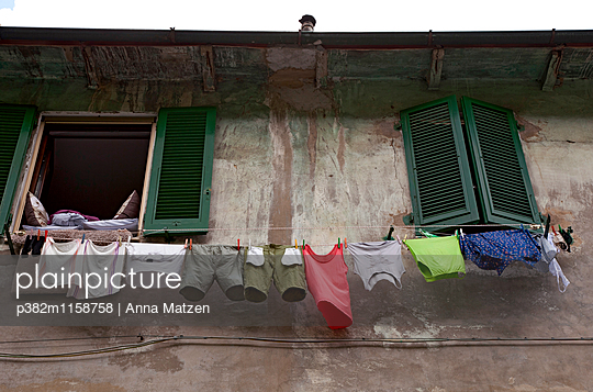 Clothesline outside the window - p382m1158758 by Anna Matzen