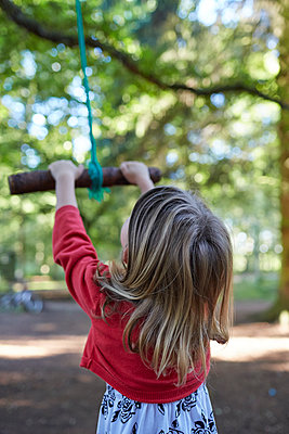 Child on rope swing  - p1612m2223695 by Heidi Coppock-Beard