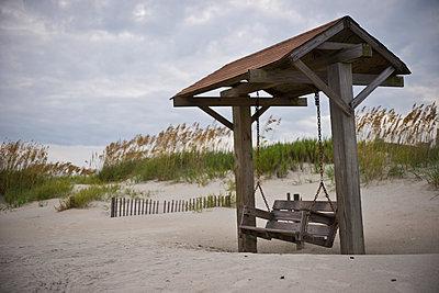 Beach swing on Tybee Island. - p1072m1106058f by Joseph Shields
