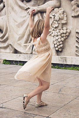 Little girl dancing outdoors - p623m1045610f by Anne-Sophie Bost
