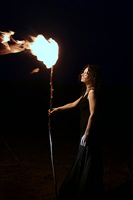 Woman with torch - p1019m739851 by Stephen Carroll