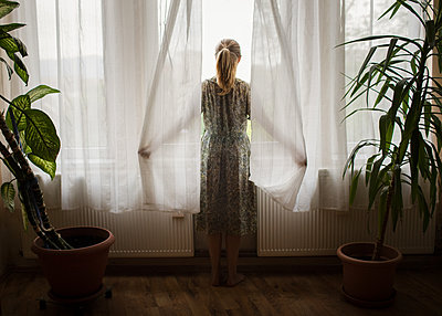 Girl Looking out of Window - p1503m2015960 by Deb Schwedhelm