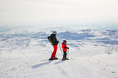 Father and son skiing - p312m2052504 by Lina Arvidsson