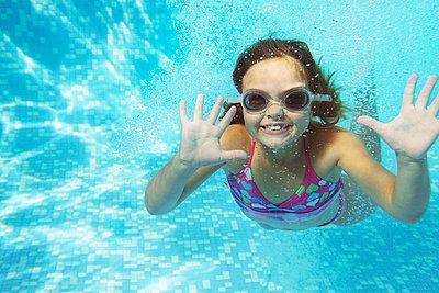 Girl swimming underwater - p42912292f by Adie Bush